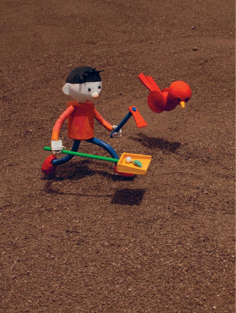 Criança com uma pá e passarinho. Página 24 do livro Era uma vez uma árvore. Imagem ilustrativa texto meio ambiente.